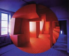 Photographer Georges Rousse paints on buildings to create optical illusions, then photographs them.