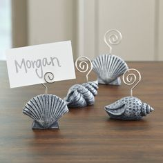 Seashell Place Card Holders | Resin casts are given an aged metal look and etched with detail to create these seashell place card holders. Set of four.