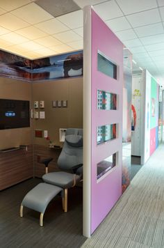 Love the bright images and clean look that DIRTT walls bring to this healthcare environment.