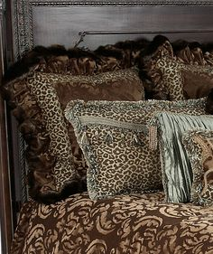 The Aristocat collection combines a yummy milk chocolate colored cut velvet with a fun leopard print, soothing spa green crushed silks, and a rich faux mink.