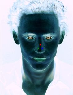 Stare at the red dot for 30 seconds, then look at the wall. Magic, Tom Hiddleston on our wall!