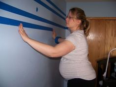 Adding stripes to the wall! I like this idea!