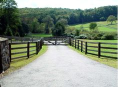 Wooden Driveway Gates Automated wood gate with post-and-rail fencing on a farm property by Tri State Gate, New York Driveway Entrance Landscaping, Driveway Fence, Driveway Design, Fence Gate, Driveway Ideas, Fence Design, Pasture Fencing, Ranch Fencing, Farm Gate