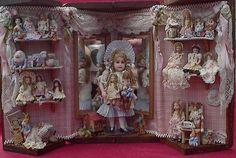 "Lynn McEntire's beautiful miniature dolls. The big one would be 4"" high."