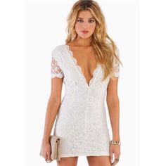 Tobi bodycon white lace dress Nice flattering fit. Low cut in the front. Worn once!!! Tobi Dresses Mini