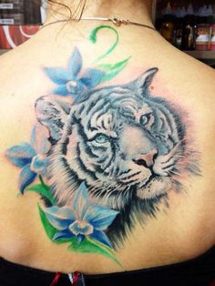 White Tiger with blue flowers - Tattoo Artist - Michele Pitacco Does amazing combos of fantasy & realism