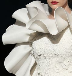 Fausto Sarli doesnt design gowns, he BUILDS them; always sculptured, structured. His creations are AMAZING>