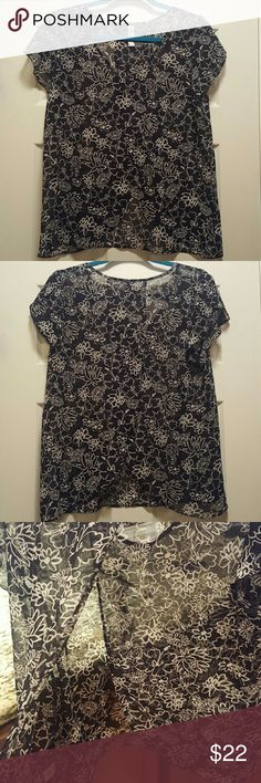 Francesca's black sheer top! NWOT! This is a beautiful sheer alya top in black with a white floral pattern! The 3rd pic shows the back where the fabric hangs in a cross-over fashion! This top was tried on, but never worn, and is in excellent condition! Francesca's Collections Tops Blouses