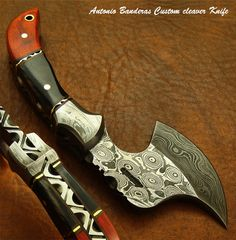 "Antonio Banderas CUSTOM DAMASCUS CLEAVER KNIFE -This 5.60"" cleaver was designed and custom made by Antonio Banderas. This gorgeous unique chopper is equipped with hand forged Damascus Blade (1095 & 15n20). This beautiful blade is the result of hours and hours of forging. Over all length of this knife is 5.60"" long, length of the blade is 2.75 inches."