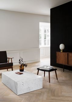 Norm Architects resurrect a historic Copenhagen Apartment that once housed Danish Designer Poul Henningsen and was devastated by fire, for a classically modern and minimal family abode. Apartment Interior Design, Living Room Interior, Modern Interior Design, Living Room Decor, Interior Decorating, Living Area, Monochrome Interior, Stone Interior, Bedroom Decor