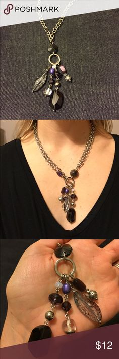 """Lia Sophia long silver chain w:multi color tassel Very pretty long chain necklace with purple, grey, silver and black beads, see close up photo for detail. The chain is a slightly chunkier chain, you can wear it long or put the toggle through the circle at the bottom to wear as a shorter option as shown in photo. while laying flat the necklace from end to end (1 way) is about 22"""" just the chain is about 18"""". gently worn, the bigger black stone at the bottom has 2 small knicks in it that you…"""