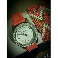 """Authentic like-new Fossil coral watch Beautiful coral time piece in like-new condition! Silicone band which you can easily switch out. Crystals galore around the watch face that make a gorgeous statement. Watch is very gently used. I bought it from another Posher 2 wks ago - never wore it as it was an """"I want"""" rather than an I need  - we all know how that goes  I've lost my job & now need to all it. There are minor scratches on the back that no one will ever see-band is in excellent…"""