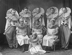 A fancifully dressed troupe of traveling performers poses for a portrait in December 1924. #clowns #circus #performers #1920s #twenties #vintage #portrait