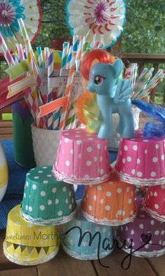 """I love the idea of calling it a """"Rainbow Dash Birthday Bash"""" on the invite and using rainbow colors for the party decor. Easy and fun. Could give big pixie sticks with rainbow dash picture attached to cheap and easy party favor."""