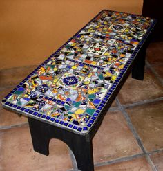 My First Mosaic Piece!  A found WOOD BENCH, retiled with broken Mexican Talavera tiles and novelty ceramic tiles.