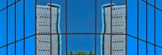 """:: REFLEJOS DE LA CIUDAD :: """"El original edificio de Endesa refleja su imagen en las cristaleras de enfrente, proyectando una composición enmarcada con el azul del cielo"""".   Entrevista a F. Higuera Molero en IndieColors Blog"""