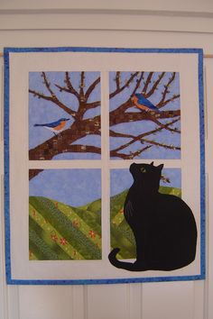 """Trouble in the Window"" from Trouble & Boo Designs - wall hanging pattern. Pattern available at 35th Ave. Fabric World in Phoenix and your local quilt shop can get it for you from  Checker Distributors or Brewer Quilting & Sewing Supplies (distributor).  Also available at Annie's catalog online."