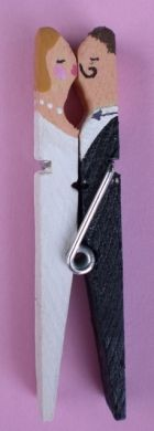 Kissing clothespin couple for the front of a wedding card