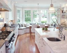 kitchen bay window sitting area that includes the table.. love how cozy it is.
