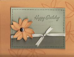 Sew seasonal flowers cut out and layered with a a brad, versa marked for background
