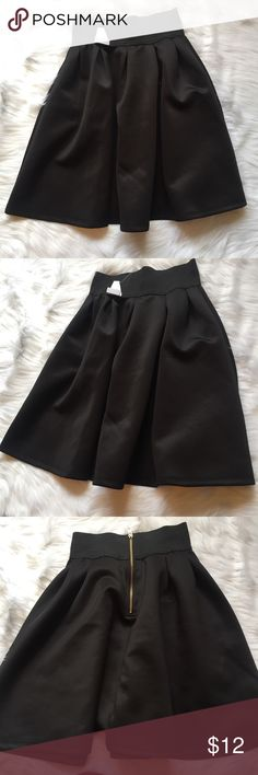 NWT High Waisted Skirt New with tags. Rue 21 size XS. Black elastic waistband with zipper detail in back. Feel free to ask any additional questions.    please make offers through offer button  bundle for a 20% off discount   smoke & pet free home   sorry no trades Rue 21 Skirts A-Line or Full