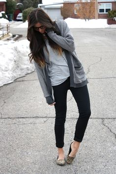 black pants, grey top and comfy sweater with necklace and leopard shoes.
