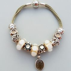 PANDORA Khaki Multi Strand Bracelet with Gorgeous Gold and White Murano and Select Charms. Just Beautiful!
