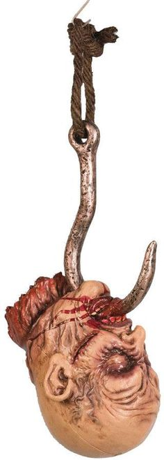 Halloween Decor: Hooked HeadMetal-looking meathook runs under jaw and up through and out of mouth through tongue. Excellent prop to hang in your haunted area. The head is the size of an actual human h
