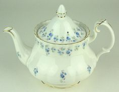 """Small Teapot in the Montrose Shape. Size : about 8 1/2"""" wide from handle to spout and  6 1/4"""" tall to top of finial. Capacity is 4 cups of tea. Pattern : Royal Albert Memory Lane This cute vintage teapot featuring forget-me-nots was made in England lovetolovedishes.com 