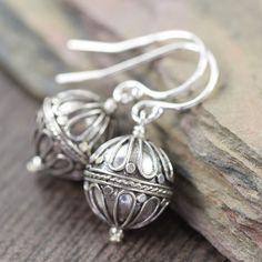 "Sterling silver ""Hot air balloon"" design bali style beads, dangle freely from sterling silver earwires. Fun, playful and chic. The sterling silver beads measure 10.5mm round with an antiqued blackened"