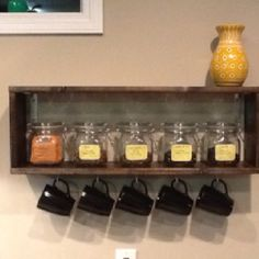 Tea Shelf. I so want to do this for all my David's Tea canisters of tea and have all my pretty mugs hanging down like that, and my tea pot up on top. It's perfect!