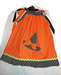 @Overstock - full cut hand crafted for fun spooky halloween party and photos -this is a pillowcase style dress it ties at shoulder with black & orange ribbons--applique hat is sewed on dress body is orange with ...http://www.overstock.com/Main-Street-Revolution/Just-Girls-Halloween-little-girls-dress/7303369/product.html?CID=214117 $22.99