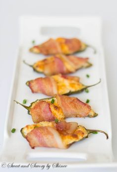 Stuffed with cheesy goodness and wrapped in bacon, these jalapeno poppers are lip smacking, finger-licking delicious either hot or cold! ~Sweet and Savory by Shinee