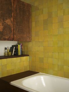 The warm, sunny aspect of the room is emphasized by the use of buttery yellow Zellige tiles and coordinating curtain fabric. The siding of the bathtub and the built in shelves are made from the same hardwearing salvaged hardwood as the kitchen surfaces. Casa Mimosa, Decor Interior Design, Interior Decorating, Yellow Tile, Vintage Light Fixtures, Vintage Lighting, Yellow Bathrooms, Room Tiles, Kitchen Tiles