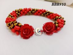 gold & red with red rose