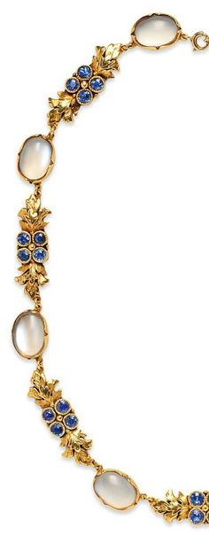An Arts and Crafts 18kt Gold, Moonstone, and Sapphire Necklace, Margaret Rogers. Composed of bezel-set moonstone cabochons spaced by foliate links with clusters of bezel-set sapphires, maker's mark. #MargaretRogers #ArtsAndCrafts #necklace