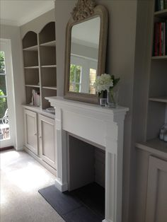 Farrow & Ball Paints: Dove Tale No 267 on chimney breast. Elephants Breath No 229 on built in cabinets left and right of fireplace.