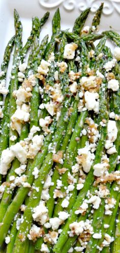 "Asparagus with Feta Roasted Garlic Asparagus with Feta. Pinner wrote ""This is the most delicious asparagus I've ever had.""Roasted Garlic Asparagus with Feta. Pinner wrote ""This is the most delicious asparagus I've ever had. Side Recipes, Vegetable Recipes, Vegetarian Recipes, Cooking Recipes, Healthy Recipes, Online Recipes, Greek Recipes, Roasted Garlic Asparagus, Asparagus"