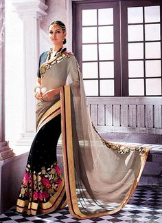 Discover the latest in stunning designer saree online. Buy this luxurious embroidered and patch border work georgette and jacquard designer saree.