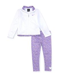 From Nike, this set features:two-piece setsolid long-sleeve brushed-back Tricot jacket featuring a stand collar (with printed interior), contrasting Nike Swoosh design trademark on the chest, an exposed pop-color zipper, and printed microfiber ruffle at the hemprinted jersey leggings with pull-on styling, an elastic waist and a wraparound Swoosh design trademark on one leg hemJacket of brushed-back Tri