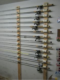 Ceiling Mounted Rod Holder Need to create my own very similar to this. Diy Fishing Rod Holder, Fishing Pole Storage, Kayak Storage, Pvc Rod Holder, Pole Holders, Rod Rack, Diy Garage Storage, Storage Organization, Storage Ideas