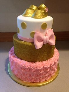 Pink and gold booties baby shower cake.