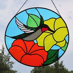 Stained Glass Hummingbird Suncatcher Ruby Throated with Yellow Orange Flowers Stained Glass Flowers, Stained Glass Designs, Stained Glass Projects, Stained Glass Patterns, Window Art, Bottle Art, Orange Flowers, Suncatchers, Mosaic Glass
