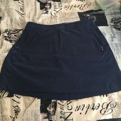 Bundle of 2 tennis skirts Cute navy tennis skirt with shorts underneath and to zip up pocket Danskin Skirts