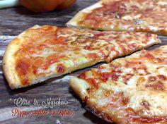Pizza sottile in teglia500 gr di farina 0 500 gr di farina 00 550 ml di acqua 25 gr di lievito di birra 20 gr di sale pizzico di zucchero