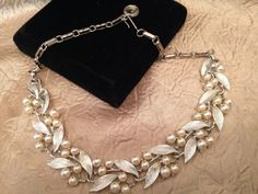 A personal favorite from my Etsy shop https://www.etsy.com/listing/258878177/lisner-silver-leaf-and-faux-pearl