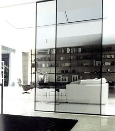 PIN NINE: SLIDING GLASS DOOR INTO A LOUNGEROOM. In this image it works as a diver to two wrongs, which creates privacy between the different areas of the house. Architecture Details, Interior Architecture, Interior And Exterior, Interior Doors, Modern House Design, Modern Interior Design, Stylish Interior, Contemporary Interior, Sliding Glass Door