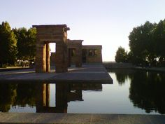 The temples, a gift from Egypt to Spain for their assistance stand in one of the parks of Madrid. Luckily, there is a security guard that keeps the tourists from walking all over the temples, which sit in a reflecting pond. Security Guard, Madrid, Pond, Egypt, Spain, Around The Worlds, Mansions, Architecture, House Styles