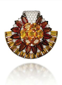 RETRO CITRINE AND DIAMOND JEWELLERY, BY CARTIER  Comprising a clip brooch of sunflower design, set with vari-cut two-toned citrines, enhanced by circular-cut diamond detail and a pavé-set diamond scrolling top, to the rectangular-cut citrine crescent trim, mounted in platinum and gold, 1950s, brooch 5.3 cm.