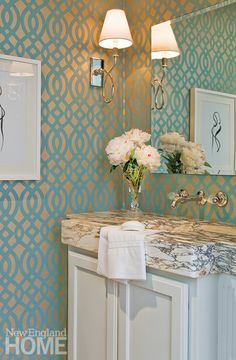 Metallic wallpaper turns a powder room into a jewel box.
